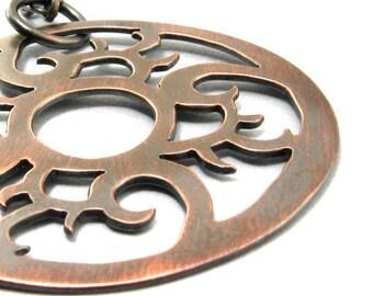 Copper pendant medallion necklace.