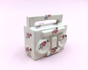 little ceramic boombox with flowers, ghettoblaster, miniature, ceramic art, hiphop-style, ceramic sculpture, 80s-style