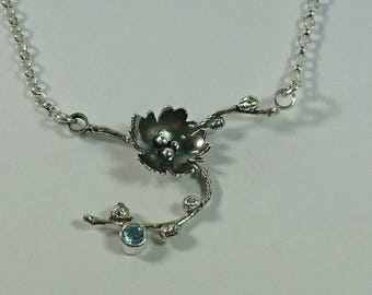 Sterling silver handmade branch necklace with hand pierced flower and 4m aquamarine. Hallmarked in Edinburgh