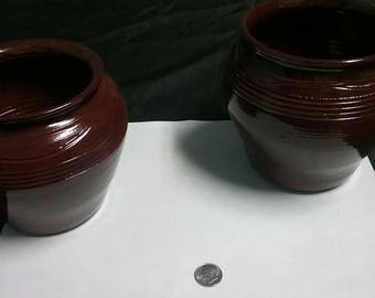 Pair of Red Terracotta Glazed pots.