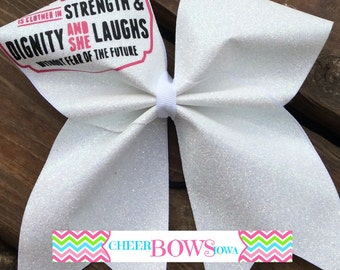 She is clothed in Strength & Dignity bow