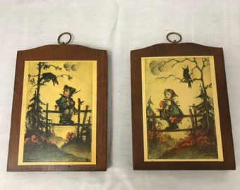 Two Wood Hummel Plaques, Boy and Girl with Crow