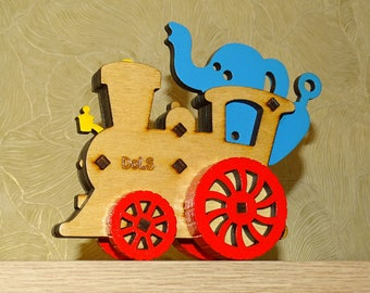 Steam locomotive with an elephant. Locomotive. Elephant. Wooden locomotive. A wooden toy.