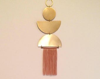 No. 3 brass wall hanging with tassels