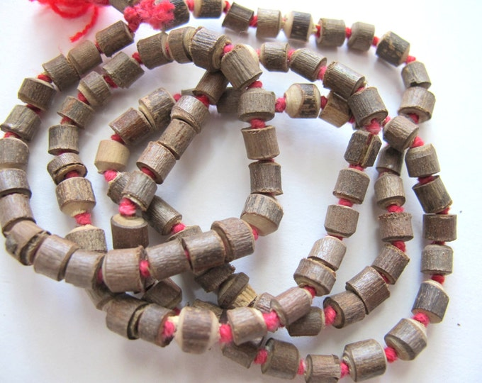 Smal size light weight Natural Tulsi seed tube beads  strand knotted  - 100 beads - NB094