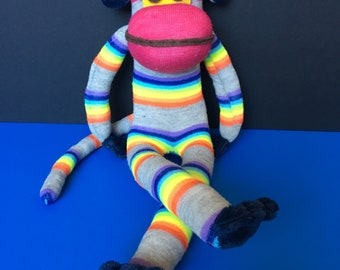 Colorful sock, fun monkey with hand and feet made of plush