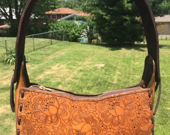 Leather purse with lace pattern