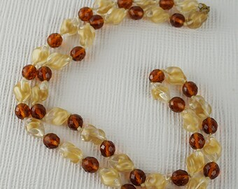 Long Beige and Brown Clear Glass Beaded Necklace  with Twisted and Faceted Beads