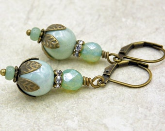 Vintage style earrings with pale green Czech glass beads