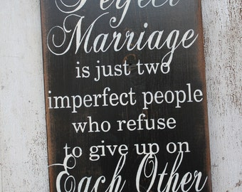 A Perfect Marriage is 2 imperfect People who refuse to give up on each other wood wedding sign
