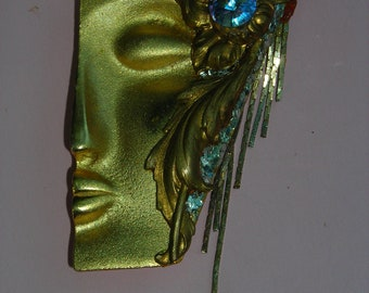 GOLDTONE WOMAN'S HALF face brooch