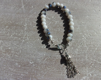 Blue and White Glass Beaded Bracelet with silver Sparkle and a chain tassel