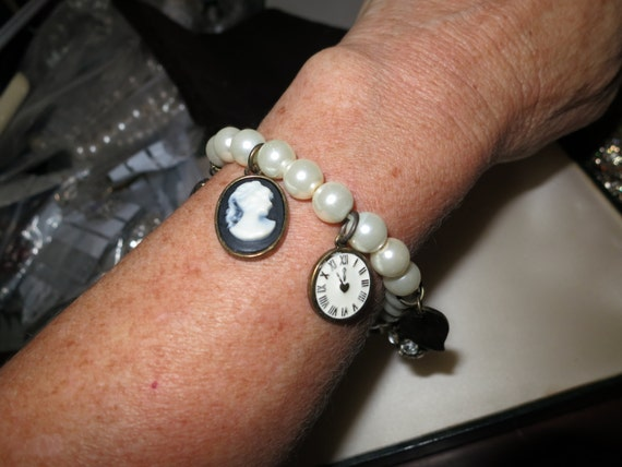 Lovely vintage white glass pearl bracelet with cameo and other charms