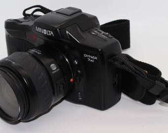 Konica Minolta Dynax 7xi 35mm SLR, 28-80mm Autofocus lens, neck strap and batteries - Very good condition and tested