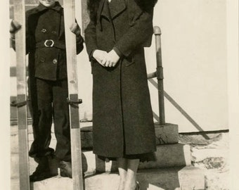 vintage photo 1944 Mother Daughter holds Skis in Winter