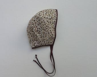 Brown floral cotton baby bonnet 0-3months
