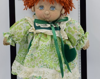 Little girl with green dress and flakes