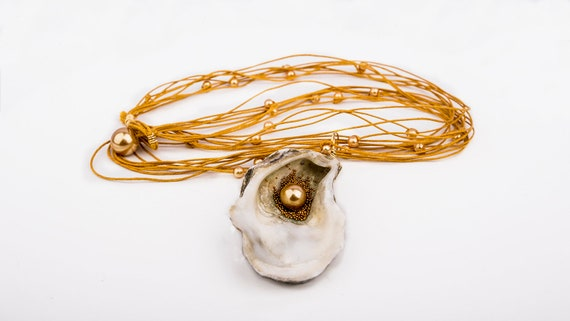 Multi strand necklace with North sea oyster shell  pendant with bead
