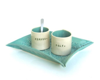 petite hand built porcelain salt and pepper cellars sitting on a tray   ...   seafoam  blue