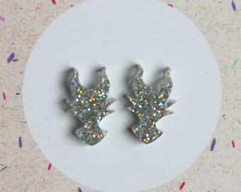 Silver holographic glitter villain stud earrings on sterling silver posts