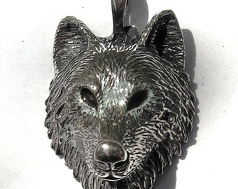 Sterling Silver Timber Wolf Pendant With Brown Eyes