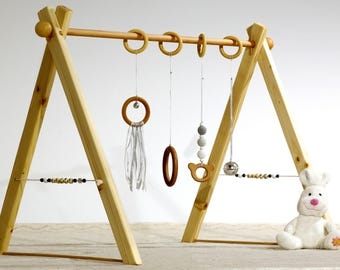 Portico educational Montessori baby gym, gray and white version, 4 rings, spheres in wood on the sides.