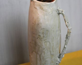 Tall white wood fired sculptural jug with spindley corally  handle