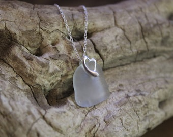 "Opaque white sea glass pendant with sterling silver heart shaped bail and 16"" sterling silver chain. Simple and elegant."