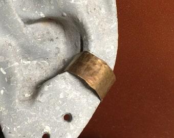 "Titanium Ear Cuff. Single. Bronze with bronze highlights. .30"" wide. Hypoallergenic."