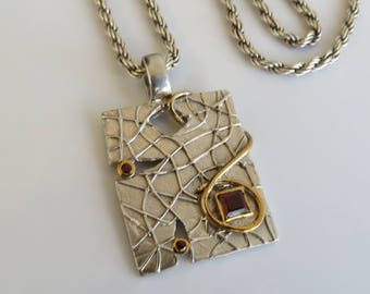 Tuyet  sterling silver 14k gold garnet abstract pendant with a sterling silver chain