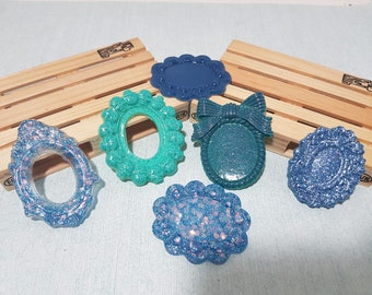 6 Resin cameo bases in shades of blue and light blue