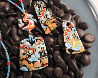 Swirl collage necklace, polymer clay pendant and focal bead on beaded necklace