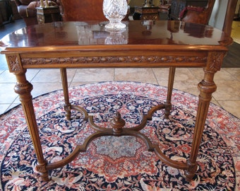 Louis XVI Style Carved Mahogany Center Table with Flame Finial