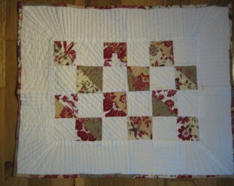 Block-style doll quilt