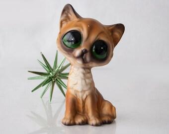 Vintage sad or big eyed pity kitty