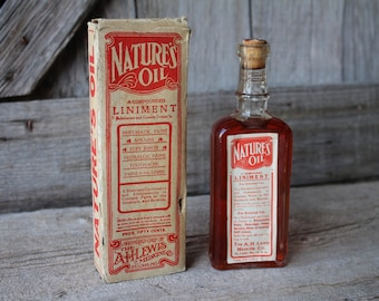 A. H. Lewis Nature's Oil Liniment Sealed Antique Corked Medicine Bottle with Box, Full Paper Label, and Insert