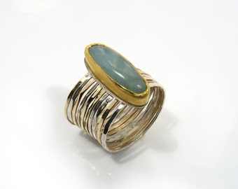 The Elegance of the Oval Ring - aquamarine on gold and silver hammered bands