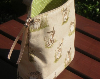Zippy bag in country hares print. So many uses. Accessory pouch. On-the-go craft projects: crochet, knitting etc. 1-2 skeins. Fully lined.
