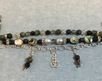 Triple strand charm bracelet with abalone, jade, and pearls