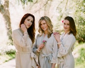 6 knee length robes in faux crepe de chine silk trimmed with lace. Bridal robes and bridesmaids robes in neutral tones.