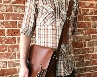The Medium Classic Satchel (pictured in Whiskey leather)