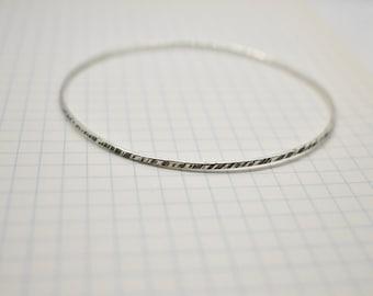 Hammered fine sterling silver bangle