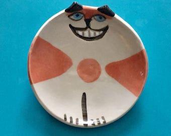 Whimsical Cheshire cat: orange white round plate  HM Pottery kitty crazy blue eyes feline theme designer pet resort  pet lover