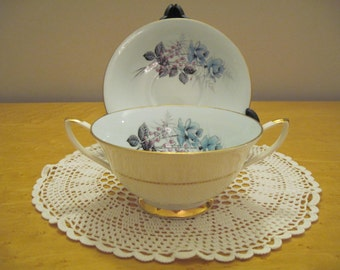 Imperial Blue Roses soup coupe and saucer, fine bone china, warranted 22kt  gold