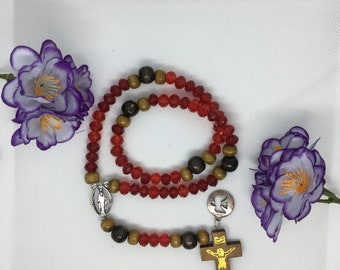 Rosary with red beads.
