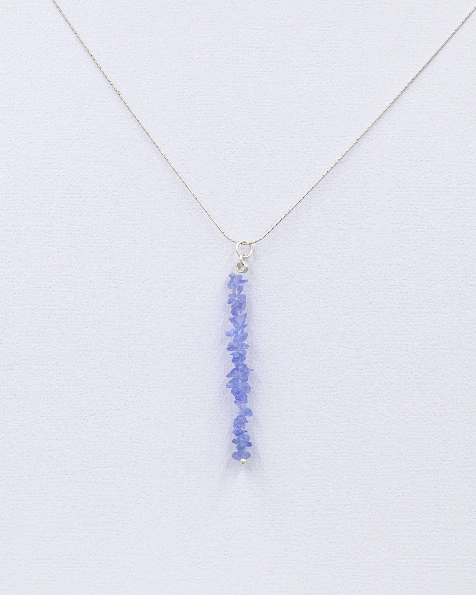 gold necklace in white tanzanite