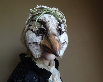 Paper mache forest bird mask