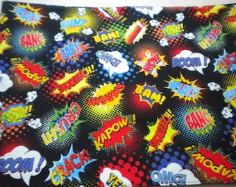 Placemat. Comic book print. Red spot backing. Sturdy cotton fabric. Fully washable. Fun, pretty,practical.