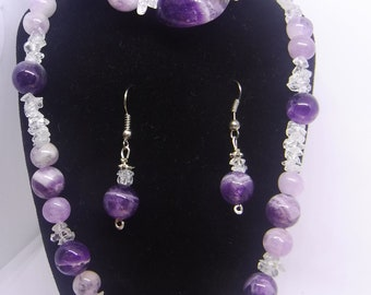 Lavender and pink Amethyst from Brazil with White Topaz chips