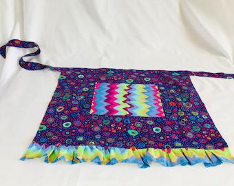 A purple waist apron